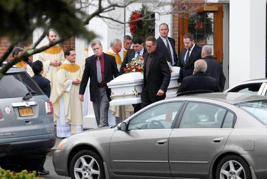 Photo by Erica Miller Pall bearers carry the casket of 6-year-old James Mattioli at his funeral service at St. Rose of Lima Roman Catholic Church on Tuesday in Newtown, Conn.