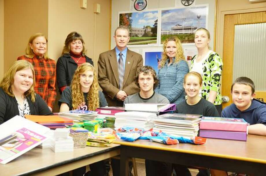 Dispatch Staff Photo by NICK WILL Vernon-Verona-Sherrill High School student ambassadors accept the donation of several school supplies from American Legion William Russell Post 404 Auxiliary members. Front from left are students Samantha Netzban, Therese Pitman, Luke Graham, Kelly Breckenridge and Glen Garnsey. Back row from left are Donna Stein, Diane Graham, Principal Andy Brown, Jessica Ouokusko and Monica Strife.
