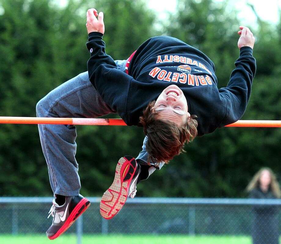 Jake Scinto of Cheshire clears 6 feet, 2 inches and goes on to win the high jump in a meet against Sheehan and Notre Dame-West Haven. Photo by Arnold Gold/New Haven Register