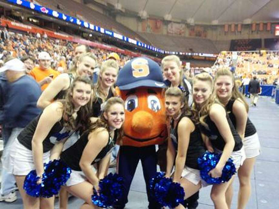 Submitted Photo by KATIE BIELBY Members of Oneida's dance team pose with Otto during Syracuse's game Monday, December 17, 2012. Front row, from left: Emily Meyers, Brooke Scribner, Alex Fellows, Courtney Corigliano, Krista Kennedy. Back row, from left: Hannah Kuhn, Gabrielle Chambers and Oneida dance team alum Julie Mondrick.