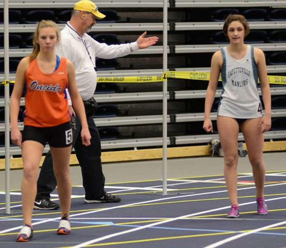 Dispatch Staff Photo by DAVID M. JOHNSONOneidaÕs Kim DeCarr, left, and Fayetteville-ManliusÕ Olivia Ryan prepare for the girls 1000 meter finals at the Section III State Qualifier at Onondaga Community College Wednesday. DeCarr finished sixth with a time of 1.44.73.