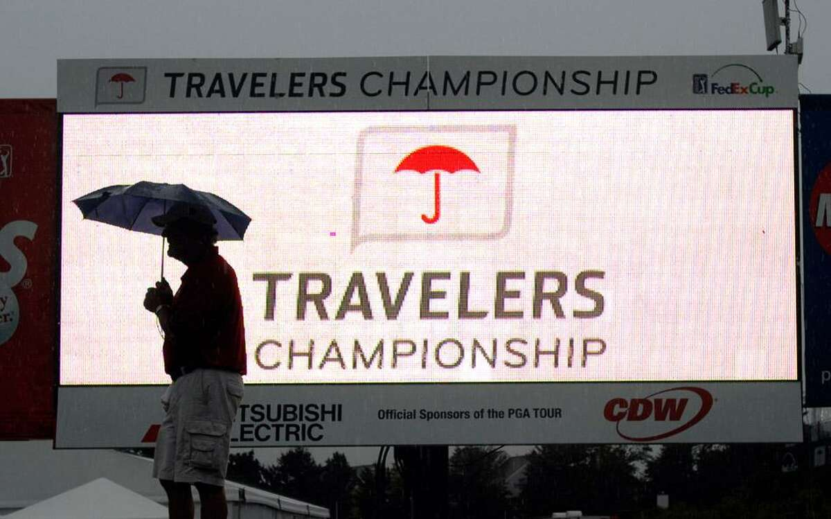 Cromwell-- Steve Bania, a marshal at the Travelers Championship golf tournament, waits for play to resume after lightning storms and rain stopped play in the mid-afternoon. Peter Casolino/New Haven Register 06/22/2012