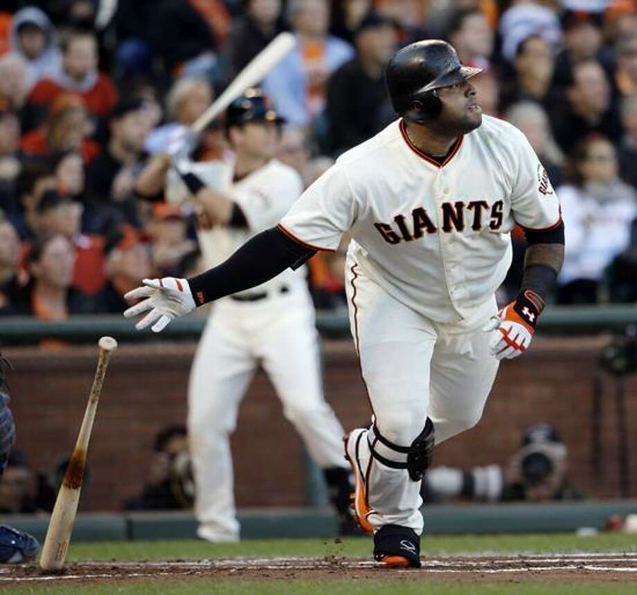 San Francisco Giants' Pablo Sandoval hits a double during the first inning of Game 6 of baseball's National League championship series against the St. Louis Cardinals Sunday, Oct. 21, 2012, in San Francisco. (AP Photo/David J. Phillip) Photo: AP / AP2012
