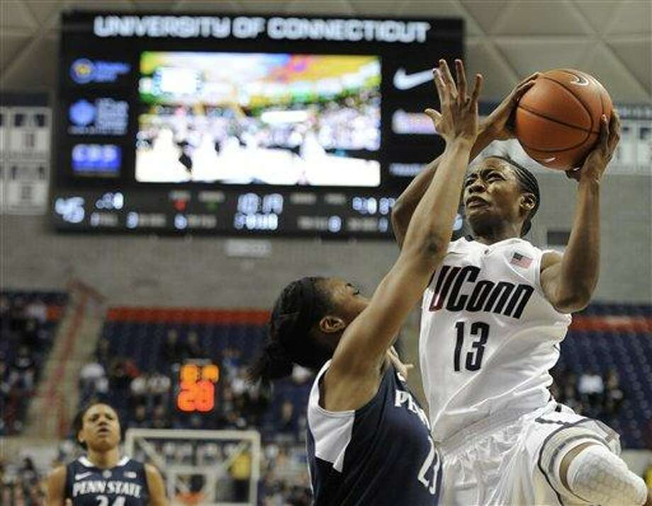 Connecticut's Brianna Banks (13) is goes up for a basket while guarded by Penn State's Ariel Edwards, during the second half of an NCAA college basketball game in Storrs, Conn., Thursday, Dec. 6, 2012. (AP Photo/Jessica Hill) Photo: ASSOCIATED PRESS / A2012