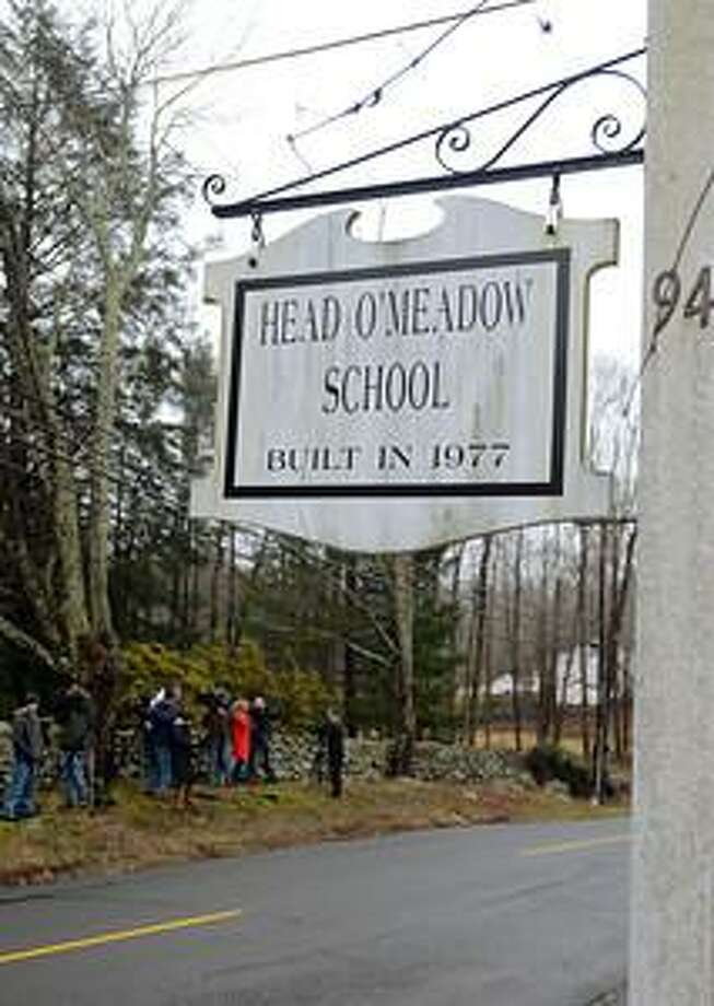 Media gathers outside Newtown's Head O'Meadow Elementary School, which was closed Tuesday, Dec. 18, after a threat was received. Julia Wilkinson/Digital First Media