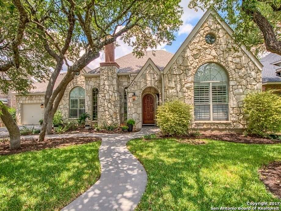 Sponsored by Mary Esther Carrasco of Re/Max North-San Antonio VIEW DETAILS for 17319 Fountain MistMLS: #1256451Beautiful one-story custom home in prestigious Fountains at Deerfield, a small gated/guarded community. This amazing home offers two living, two dining, elegant formals, gourmet island kitchen with granite counters and new Bosch dishwasher, breakfast area and bar with stone accent. Fourth bedroom with own bath (currently a study) could be mother-in-law/guest suite; split master suite with remodeled master bath and large walk-in shower. Gorgeous handcrafted wood door with stained glass window at entry. Wood floors, plantations shutters and updates galore!Mary Esther Carrasco with Re/Max North-San Antonio Photo: Photo Provided By Re/Max North