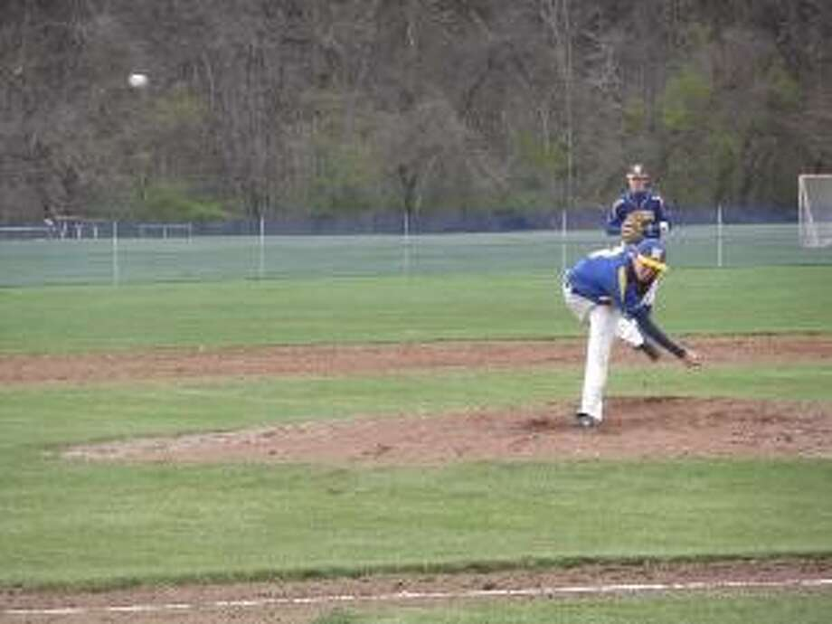 KEVIN D. ROBERTS/Register Citizen Housatonic starting pitcher Brandon Coe delivers during Tuesday afternoon's 4-2 Berkshire League loss to Lewis Mills at Housatonic Valley Regional High School in Falls Village.