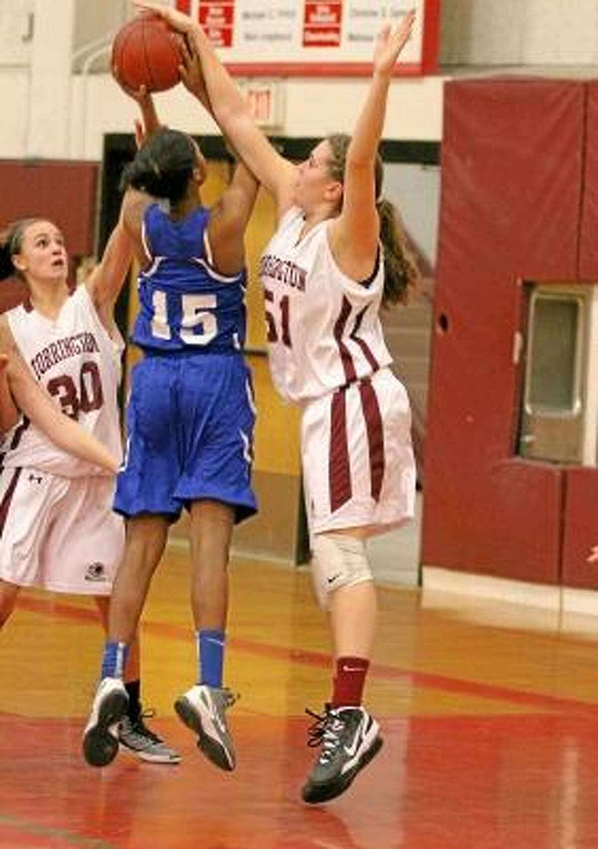 Megan Calabrese (#51) defends as a Crosby player goes up for a shot as teammate Olivia Morrison (#30) looks on