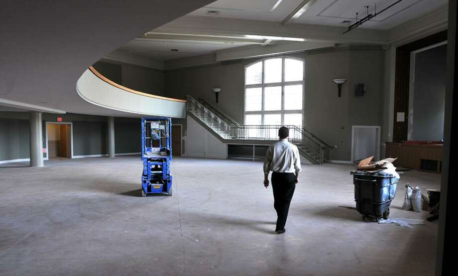 Joe DeSanti, project executive for Diggs Construction, walks through the new auditorium at the new Hamden government center construction site. Peter Casolino/New Haven Register
