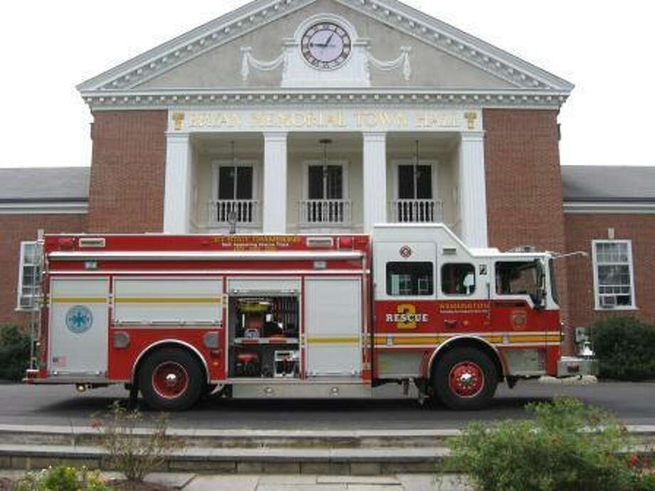A fire truck outside Bryan Memorial Town Hall in Washington, where there was an early-morning explosion Sunday after a caterer's vehicle dislodged a valve on an underground propane gas tank. Photos courtesy of Gary Fitzherbert, the town's Zoning Commission chairman.