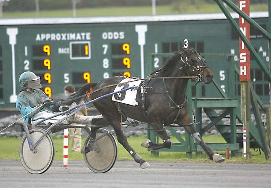 "Dispatch Staff Photo by JOHN HAEGER <a href=""http://twitter.com/oneidaphoto"">twitter.com/oneidaphoto</a> BJ's Superman driven by Michael Miller crosses the finish line to win the opening qualifier of the night with a time of 2:02 at Vernon Downs on Tuesday, April 24, 2012."
