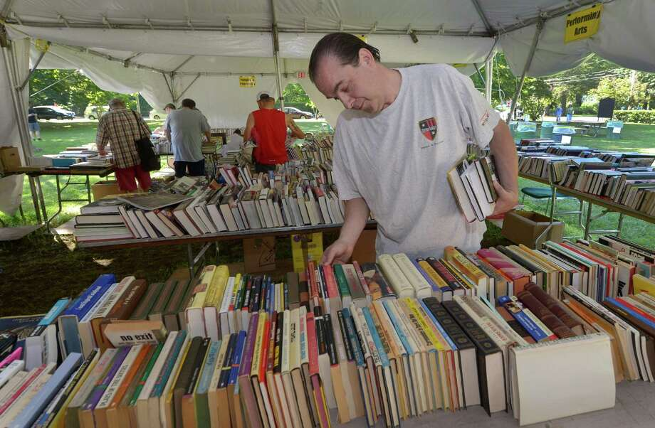 Westport resident Tim Foisie shops for books during The Pequot Library's 57th Annual Summer Book Sale July 21 in Fairfield. Photo: Erik Trautmann / Hearst Connecticut Media / Norwalk Hour