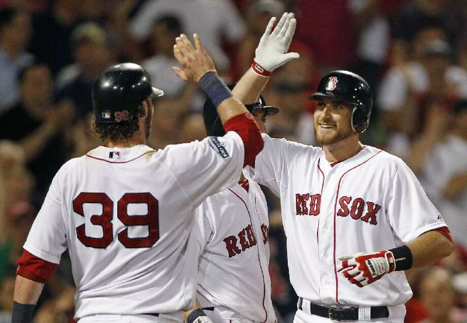 ASSOCIATED PRESS Boston Red Sox player Will Middlebrooks, right, is congratulated by Jarrod Saltalamacchia (39) after his two-run home run against the Miami Marlins during the eighth inning Thursday night's game at Fenway Park in Boston. The Red Sox won 6-5.