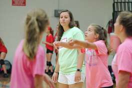 Friendswood volleyball coach Sarah Paulk observes as players participate in drills at the Friendswood summer volleyball camp Thursday, Jul 27.