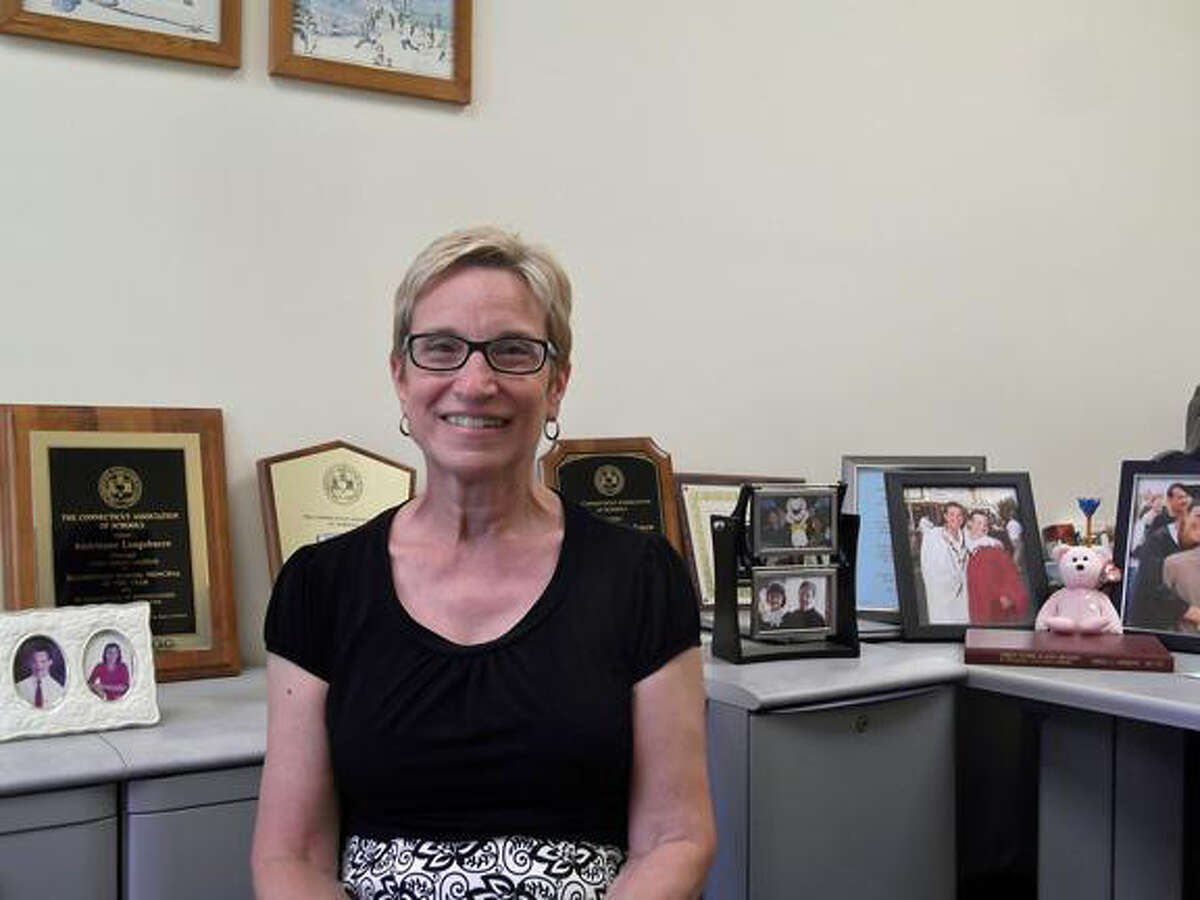MICHELLE MERLIN/Register CitizenOutgoing Center School principal Andrienne Longobucco sits in her office, which is full of her many awards.