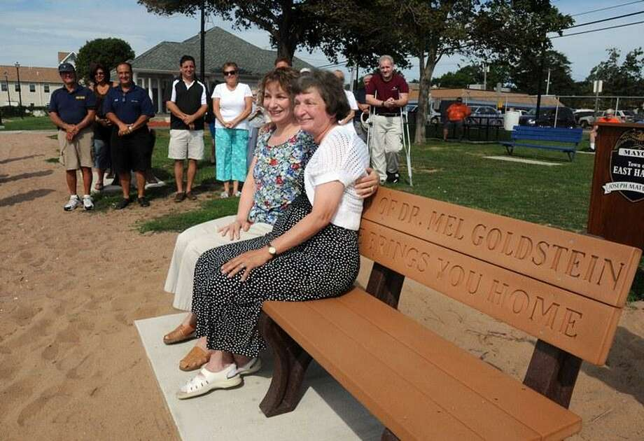 WTNH-TV meteorologist Dr. Mel Goldstein was remembered today in a small ceremony with the unveiling of a park bench that had been donated by Goldstein's wife Arlene, right, at the East Haven Town Beach. With Arlene is daughter Laura. Mara Lavitt/New Haven Register