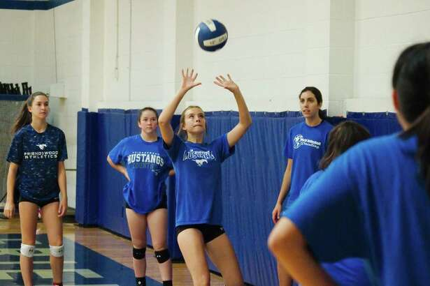 Rylee Burris participates in a drill at the Friendswood summer volleyball camp Thursday, Jul 27.