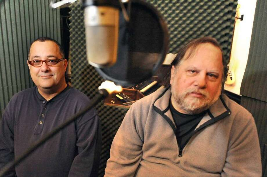 Michael Caplan and Vic Steffens pose for a photo in thier West Haven studio Tuesday Ferbuary 21, 2012- home of Elm City Music which has secured a production and distribution deal with EMI. VM Williams 02.21.12