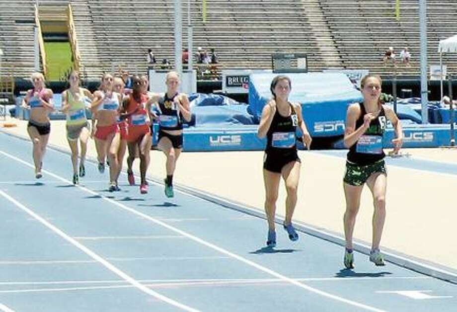 Submitted Photo Sage Hurta, right, leads the pack in a race this spring.