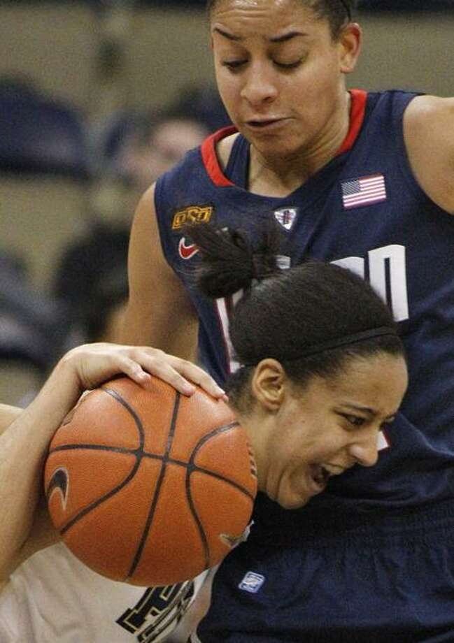 Pittsburgh's Brianna Kiesel, left, drives into Connecticut's Bria Hartley during the first half of an NCAA college basketball game Tuesday, Feb. 21, 2012, in Pittsburgh. (AP Photo/Keith Srakocic) Photo: AP / AP