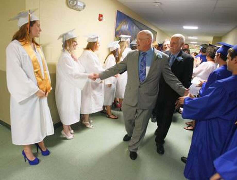 Dispatch Staff Photo by JOHN HAEGER (Twitter.com/OneidaPhoto)Madison School  Superintendent Perry Dewey congratulates members of the Class of 2012  before the start of Madison Central School's commencement on Friday, June 22, 2012 in Madison.