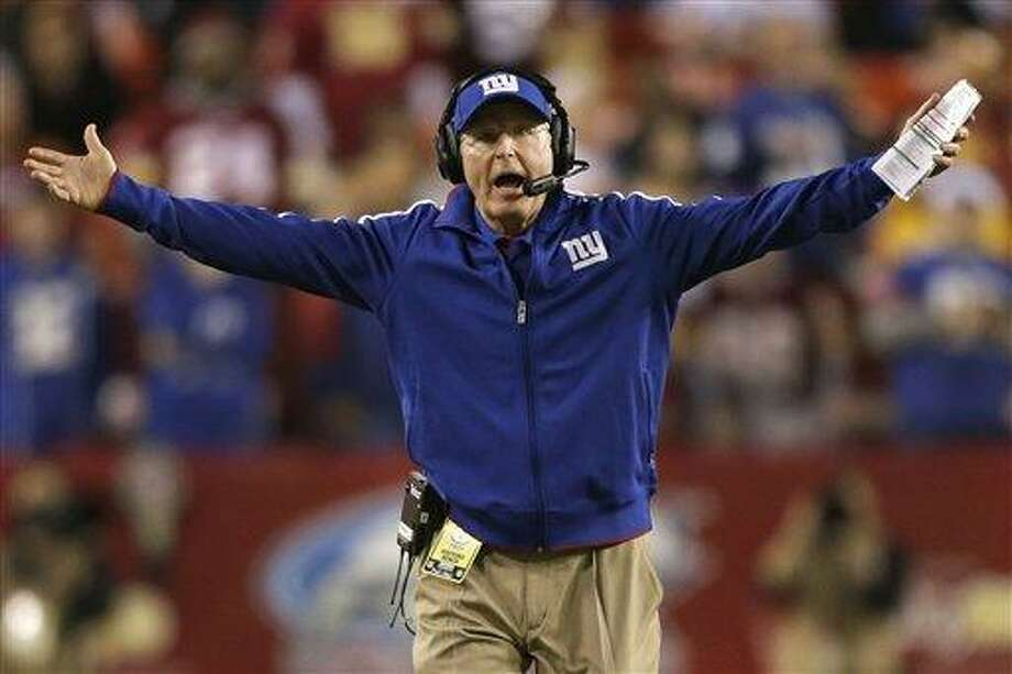 New York Giants head coach Tom Coughlin reacts to a call during the first half of an NFL football game against the Washington Redskins in Landover, Md., Monday, Dec. 3, 2012. (AP Photo/Evan Vucci) Photo: ASSOCIATED PRESS / AP2012