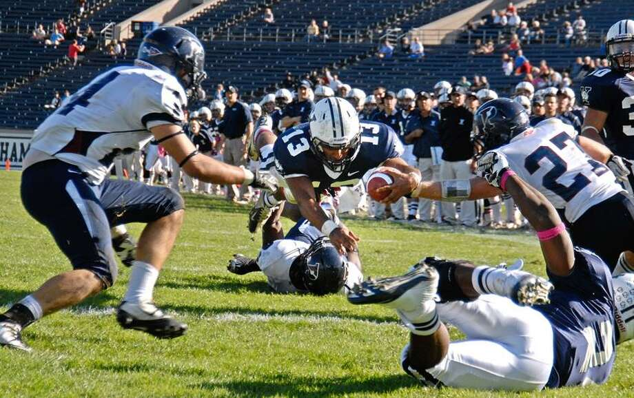 New Haven-- Yale QB Derek Russell dives into the Penn end zone for a TD in the 4th quarter, putting Yale up 27-13 .  Photo by Peter Casolino/New Haven Register 10/20/12