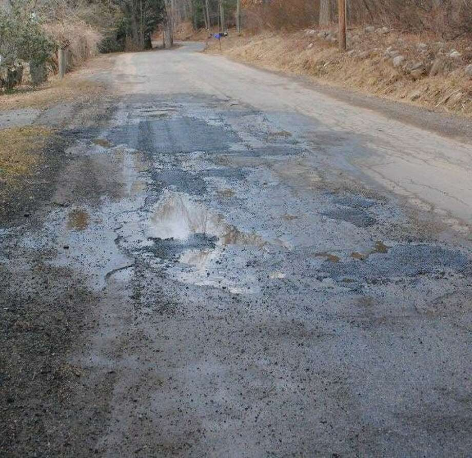 MIKE AGOGLIATI/ Register Citizen Steele Road has weathered a mild winter thus far, and will see repair work this spring.