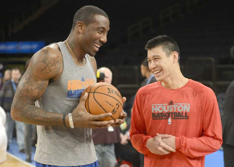 Houston Rockets' Jeremy Lin, right, talks to former New York Knicks teammate Amare Stoudemire before an NBA basketball game at Madison Square Garden in New York, Monday, Dec. 17, 2012. The game marks Lin's return to New York after leaving in the offseason. (AP Photo/Henny Ray Abrams) Photo: AP / AP2012