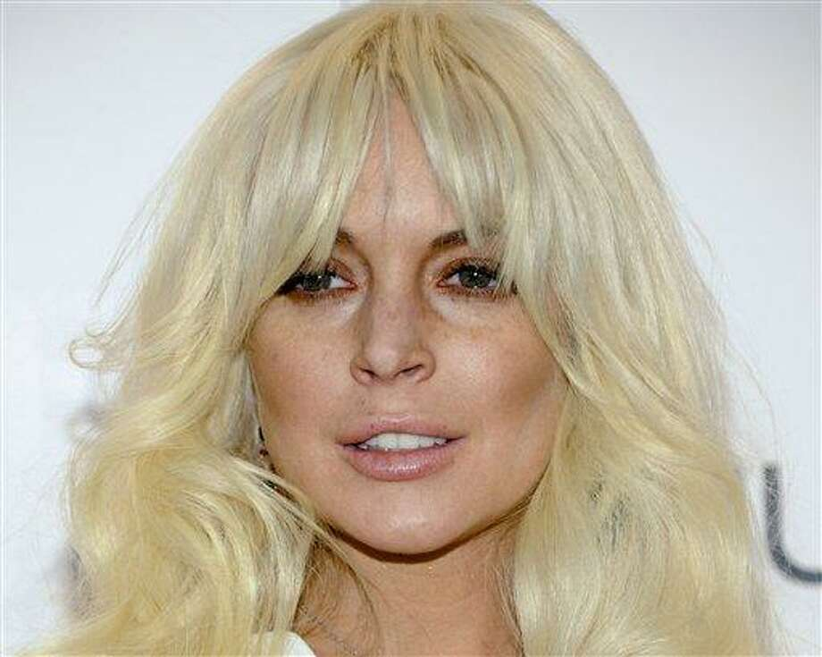 In this file photo, actress Lindsay Lohan attends amfAR's New York gala benefit at Cipriani Wall Street in New York. Lohan, whose career in recent years has been upstaged by legal and personal problems, will serve as guest host of 'Saturday Night Live' on March 3, 2012. Musical guest that night will be Jack White, the network said Sunday, Feb. 19, 2012. (AP Photo/Evan Agostini, File) Photo: ASSOCIATED PRESS / AP2012