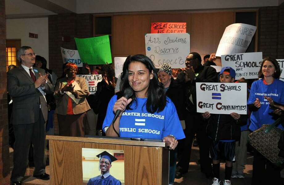 Reshma Singh, VP of external relations at Achievement First speaks during a press conference announcing the Board of Alderman was voting to build a new Amistad High School. Peter Casolino
