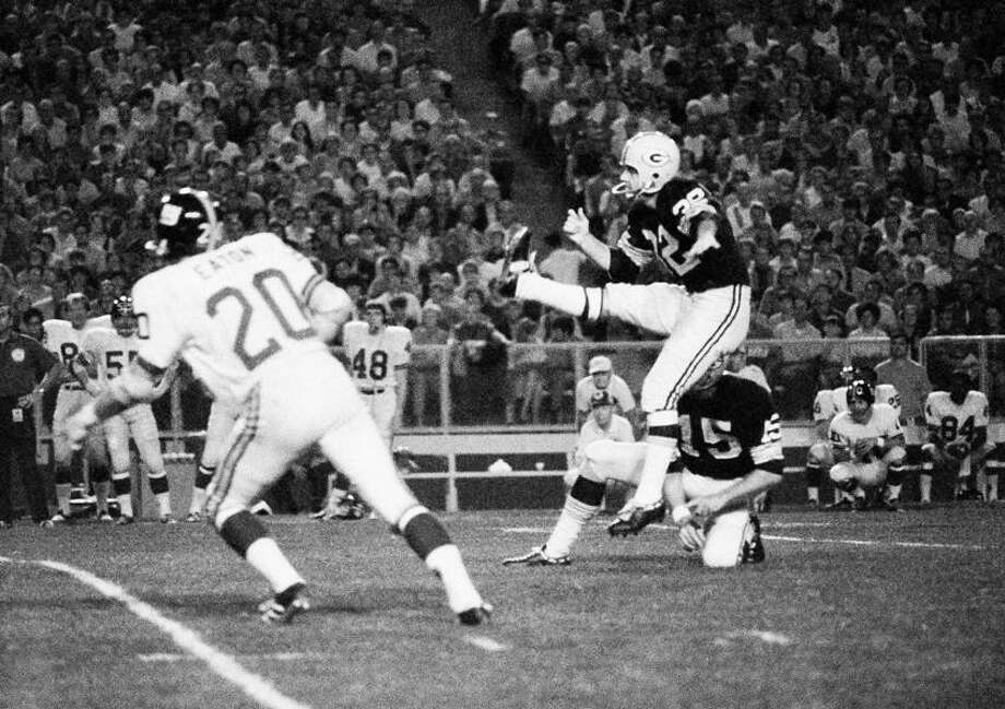Packers' Booth Lusteg (32) boots a long field goal that tied score at 10-10 in first quarter of Packers-New York Giants exhibition game, Saturday, August 9, 1970 at Green Bay. Lusteg kicked one field goal?s and four extra points to help his team end the contest with a 31-31 tie. (AP Photo) Photo: ASSOCIATED PRESS / AP1970