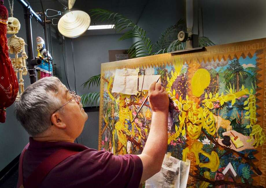 New Haven--Glen Williams, of Hamden, works on a painting as he displays other work. This is the  final week-end of the 15th Anniversary Crystal Edition of City-Wide Open Studios.  More than 100 artists displayed their work at the New Haven Register.   Melanie Stengel/Register