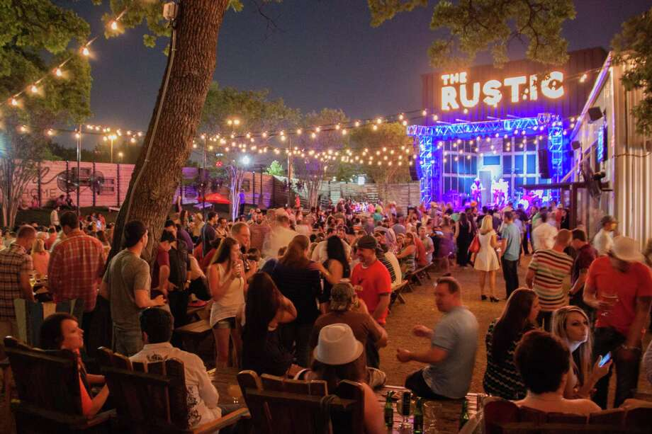 "The Rustic is set to open in mid-September at The Rim and will feature live music outdoors in ""Pat's Backyard,"" a venue named after Texas musician Pat Green, who is a part of the ownership group. The Dallas location, after which the S.A. location will be closely modeled, is among the biggest sellers of booze in North Texas, with annual sales exceeding $6 million. Photo: Courtesy The Rustic / FreeRange Concepts All Rights Reserved 2014"