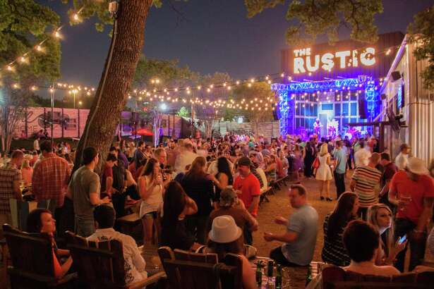 """The Rustic is set to open in mid-September at The Rim and will feature live music outdoors in """"Pat's Backyard,"""" a venue named after Texas musician Pat Green, who is a part of the ownership group. The Dallas location, after which the S.A. location will be closely modeled, is among the biggest sellers of booze in North Texas, with annual sales exceeding $6 million."""