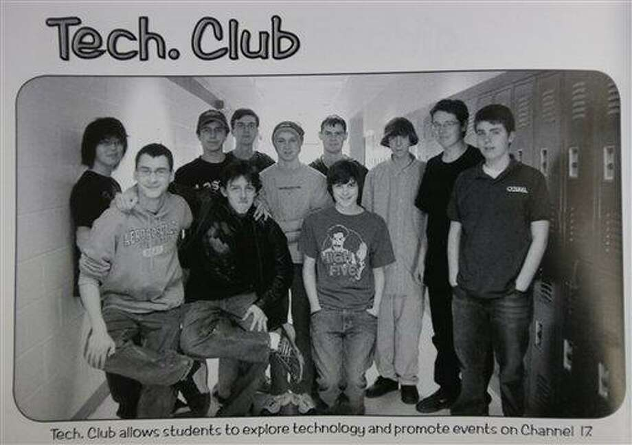 This undated photo shows Adam Lanza, third from the right, posing for a group photo of the technology club which appeared in the Newtown High School yearbook. Authorities have identified Lanza as the gunman who killed his mother at their home and then opened fire Friday, Dec. 14, 2012, inside an elementary school in Newtown, Conn., killing 26 people, including 20 children, before killing himself.  Richard Novia, a one-time adviser to the technology club, verified that the photo shows Lanza. (AP Photo) Photo: AP / AP