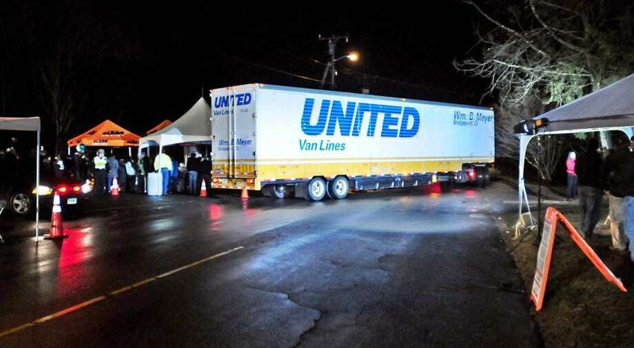 A United Van Lines moving van leaves Sandy Hook Elementary School on Monday night 12/17/2012.Photo by Arnold Gold/New Haven Register