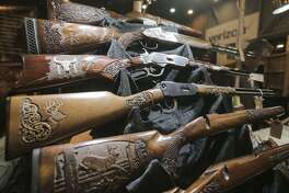 Hand-carved guns by Jose Valencia, out of Destin, Florida, are on display at the Hunters Extravaganza sponsored by the Texas Trophy Hunters Association at the NRG Center in Houston on Aug. 13, 2016.