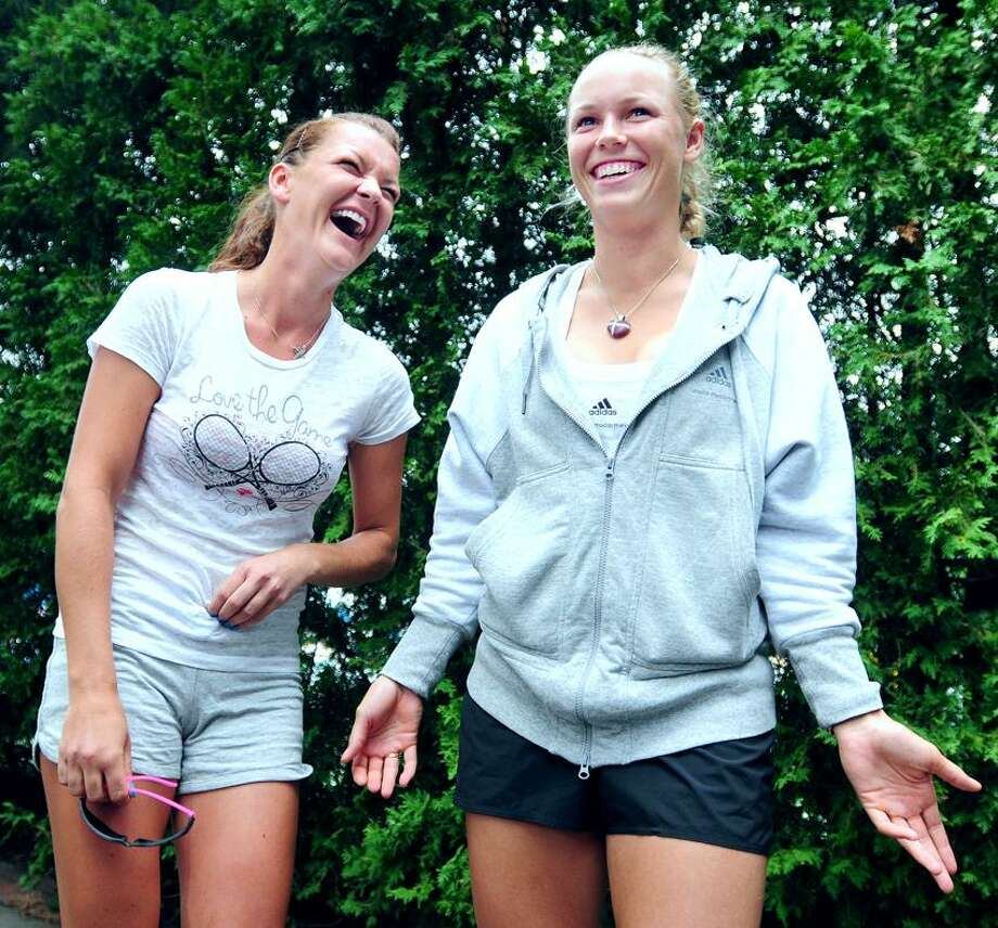 Agnieszka Radwanska (left) and Caroline Wozniacki (right) share a laugh during an impromptu trivia game between the two at the New Haven Open at Yale on 8/19/2012.Photo by Arnold Gold/New Haven Register