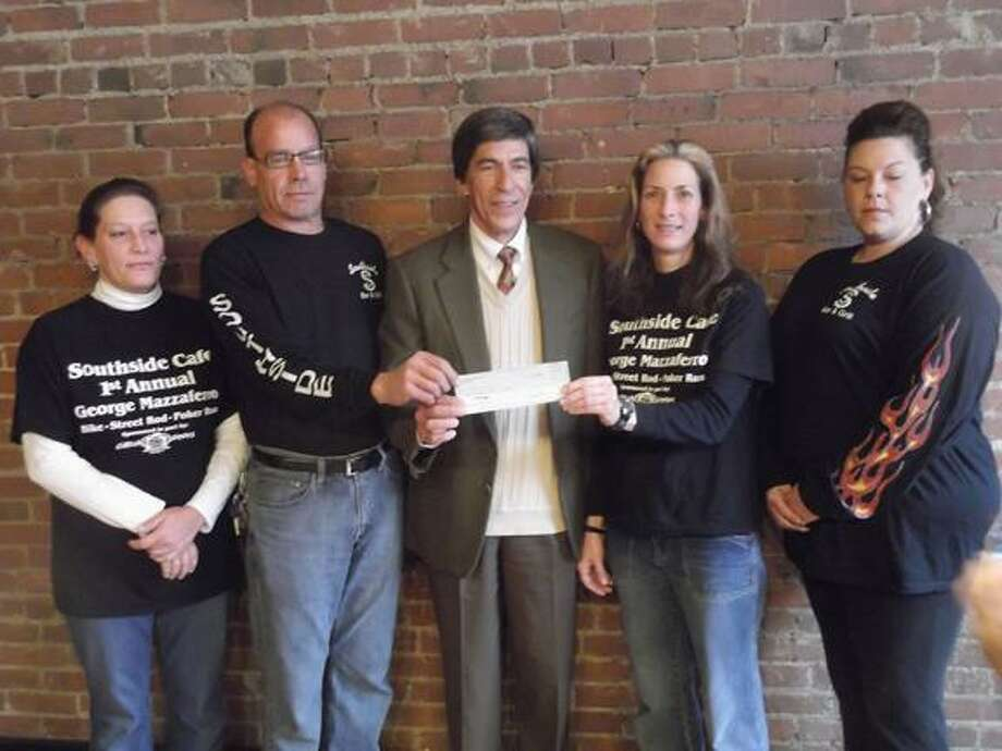 RICKY CAMPBELL/ Register Citizen The Southside Cafe donated over $1,000 to the Community Foundation of Northwest Connecticut on Friday, with the funds coming from its fundraiser in memory of a former owner.