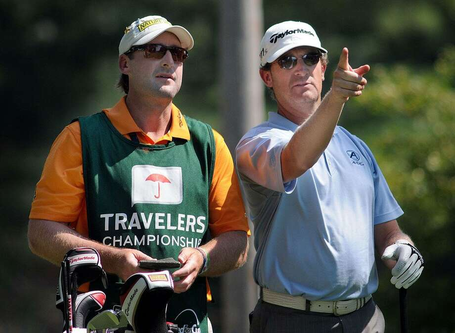 Travelers Championship golf at the Tournament Players Club, Cromwell, first day. David Mathis right discusses the fifth hole with his caddy. Mara Lavitt/New Haven Register6/21/12