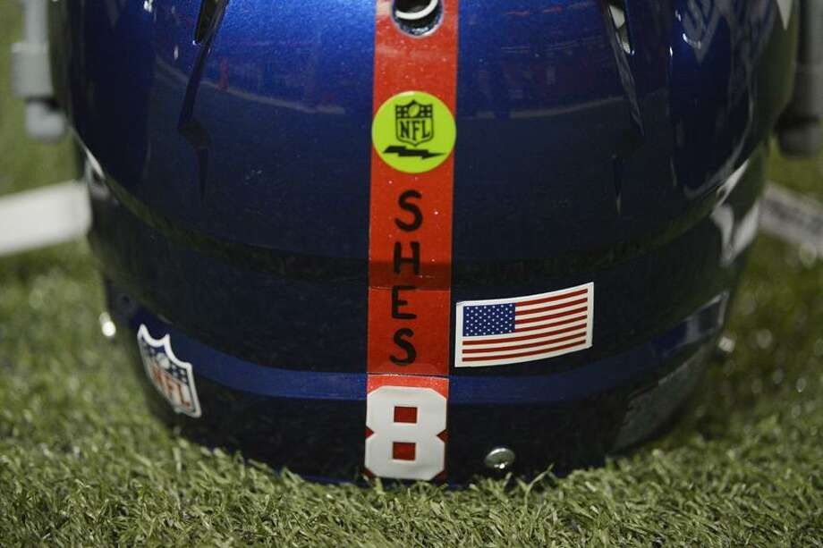 New York Giants helmets with a decal honoring the victims of the Sandy Hook Elementary School shooting rest on the turf before the first half of an NFL football game against the Atlanta Falcons, Sunday, Dec. 16, 2012, in Atlanta. A gunman walked into Sandy Hook Elementary School in Newtown Friday and opened fire, killing 26 people, including 20 children. (AP Photo/Rich Addicks) Photo: AP / FR170246 AP