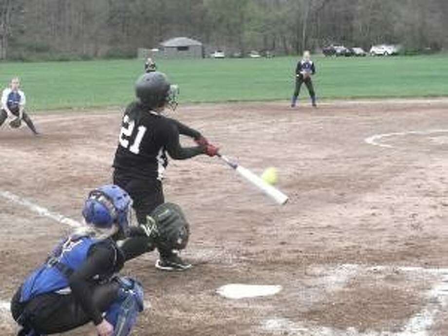 KEVIN D. ROBERTS/Register Citizen Thomaston's Erin O'Neill makes solid contact during her team's 8-4 loss to Nonnewaug in a Berkshire League softball game on Monday afternoon at Nonnewaug High School. O'Neill flew out to right on the play. She scored a run in the game for the Bears.