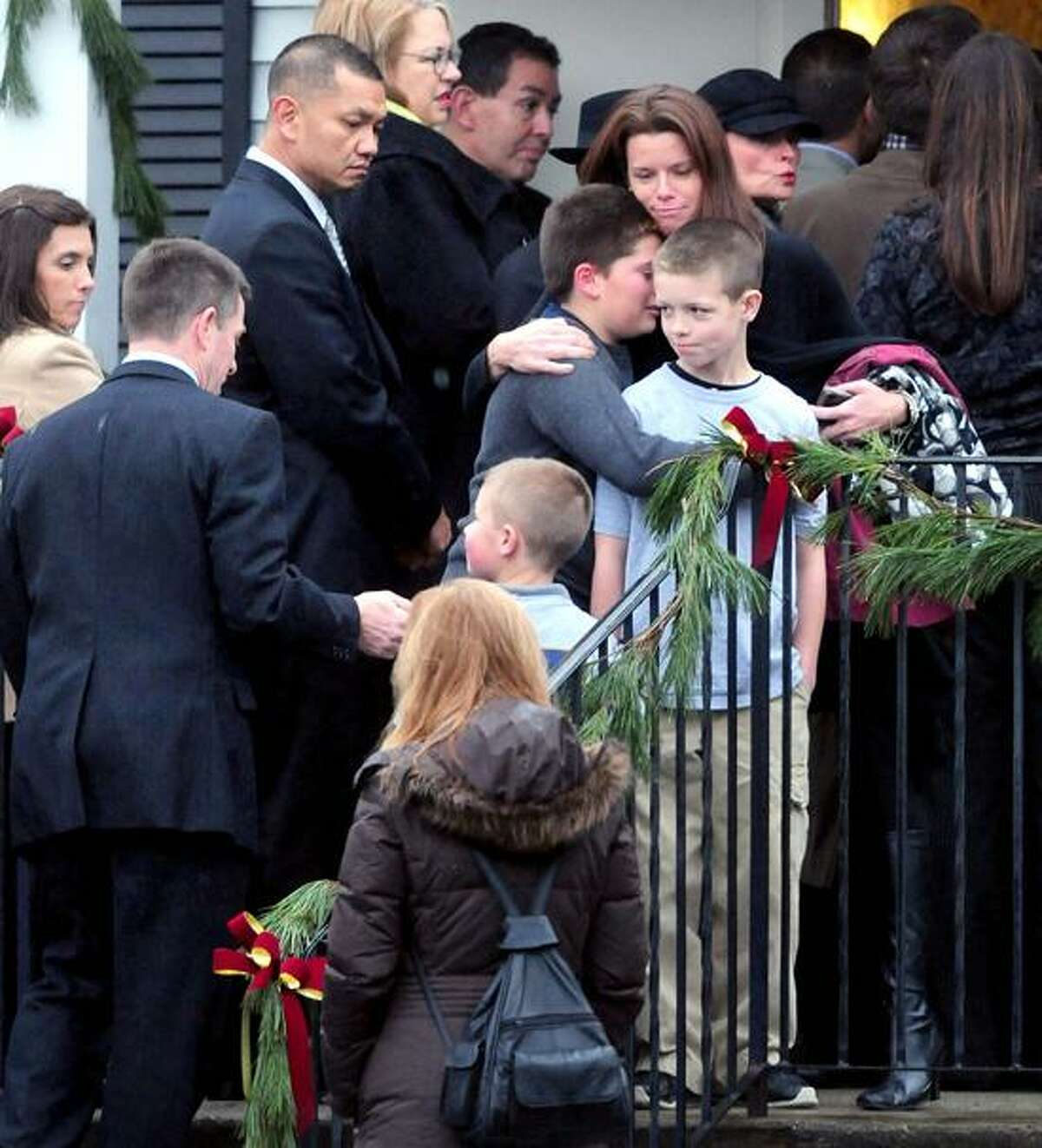 Mourners stand in line at the Honan Funeral Home in Newtown on 12/17/2012 for the funeral service of six-year-old Jack Pinto, a victim of the Sandy Hook Elementary School shootings.Photo by Arnold Gold/New Haven Register