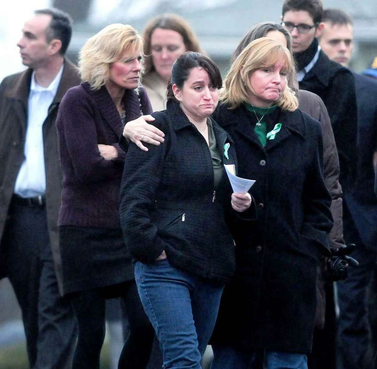 Mourners leave the Honan Funeral Home in Newtown on 12/17/2012 after funeral services for six-year-old Jack Pinto, a victim of the Sandy Hook Elementary School shootings.Photo by Arnold Gold/New Haven Register