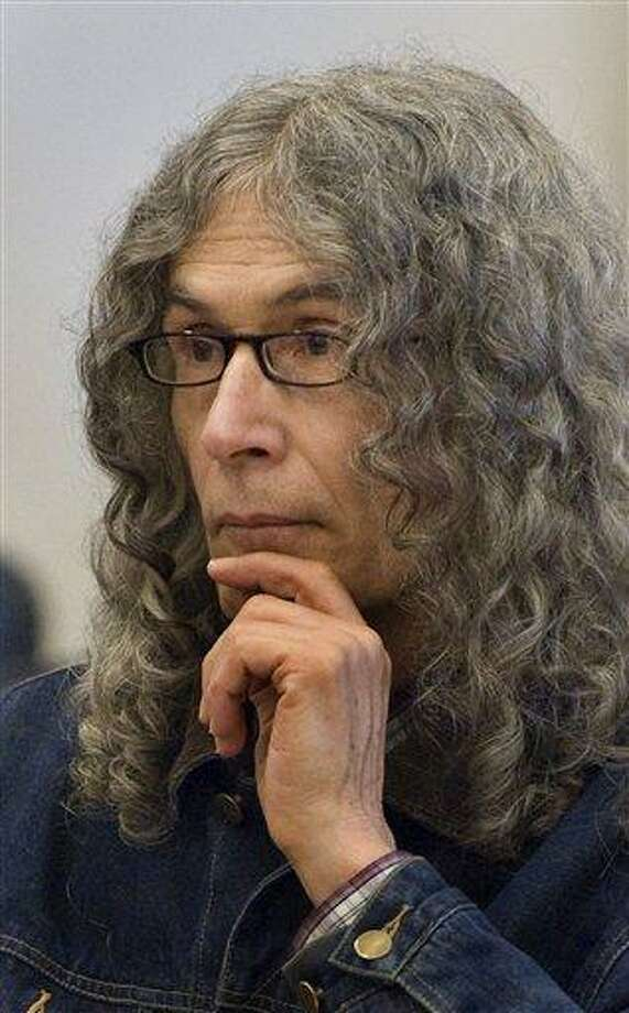 "In this 2010 file photo, convicted serial killer Rodney Alcala listens as victim-impact statements are read in a Santa Ana, Calif. On Wednesday, Alcala was headed to New York to face charges of killing two young women, Cornelia Crilley and Ellen Hover, in the 1970s, the Manhattan district attorney's office said. Alcala, a photographer and former ""Dating Game"" contestant, has been on death row in California for the 1970s stranglings of four women and a 12-year-old girl. Associated Press Photo: AP / The Orange County Register."