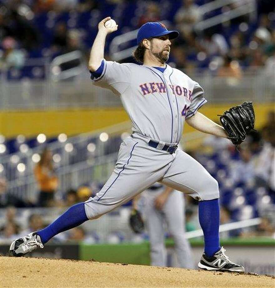 New York Mets' R.A. Dickey pitches against the Miami Marlins in the first inning of a baseball game in Miami, Tuesday, Oct. 2, 2012. (AP Photo/Alan Diaz) Photo: ASSOCIATED PRESS / AP2012