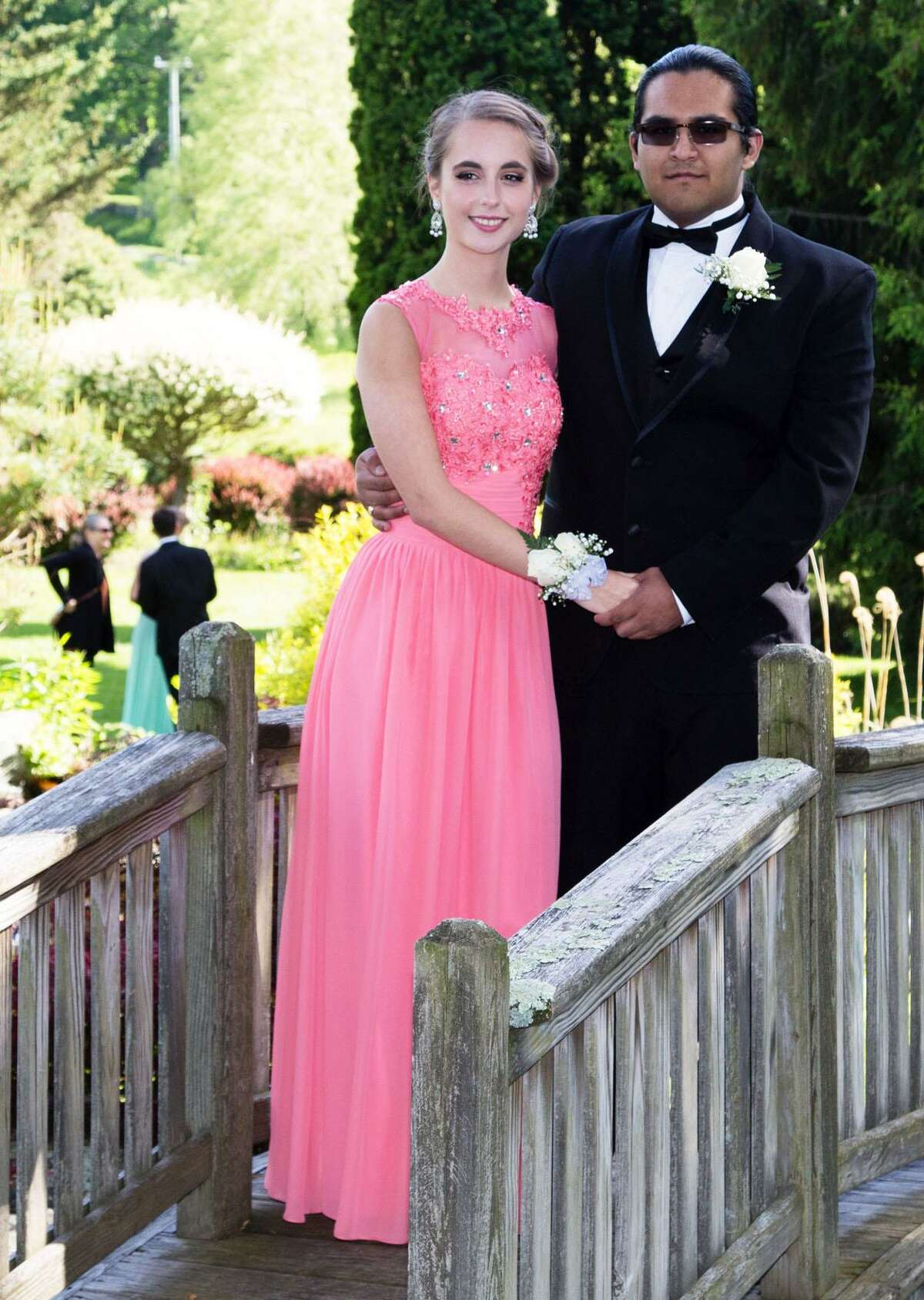 Glenholme School students Sarah Marsh and Ditoyyo Billie pose for traditional photos during the pre-prom gathering in the Garden Field at the school.