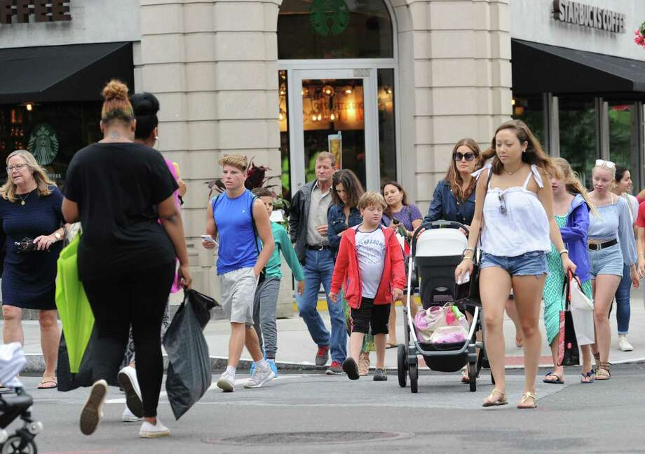 Shoppers throng Greenwich Avenue on July 14, 2017, in Greenwich, Conn. for the town's annual Sidewalk Sale Days. Photo: Bob Luckey Jr. / Hearst Connecticut Media / Greenwich Time