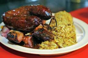 A plate of ribs and sausage sits ready to be picked up at the serving window. The re-opened Patillo's on Washington Blvd. is our restaurant of the week.  Dave Ryan/The Enterprise